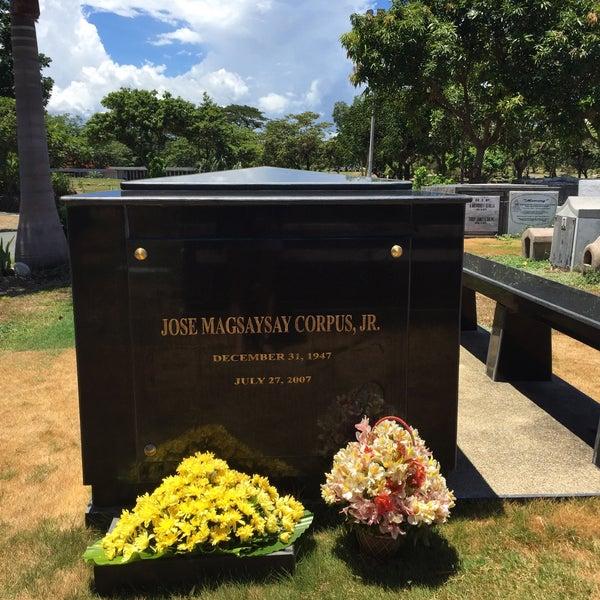 Photo taken at Manila Memorial Park by Trissie C. on 6/8/2015