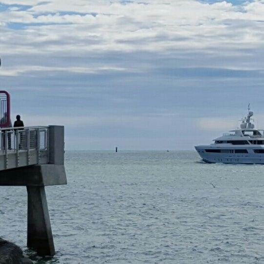 Photo taken at South Pointe Pier by E L. on 2/7/2016