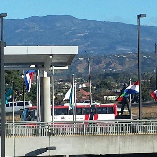 Photo taken at Gate 5 Aeropuerto Internacional Juan Santamaria by Kim M. on 2/21/2014