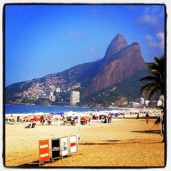 Photo taken at Praia de Ipanema by Jacson B. on 8/2/2013