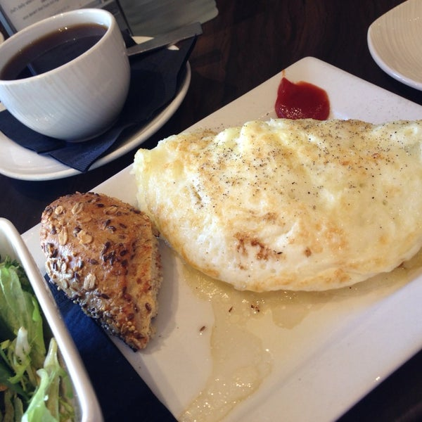 Photo taken at Glow Restaurant by Cynthia C. on 11/3/2013
