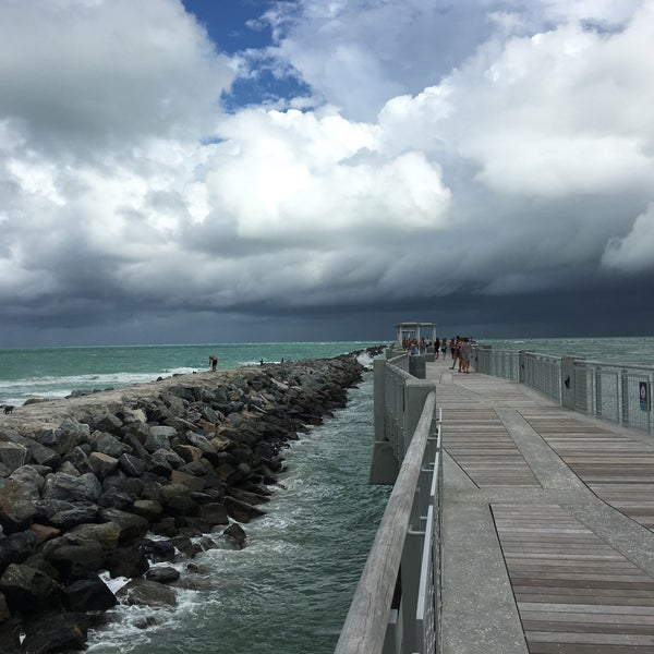 Photo taken at South Pointe Pier by Erick B. on 10/16/2016