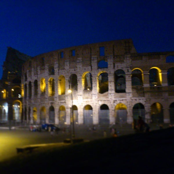 Photo taken at Piazza del Colosseo by Nara Y. on 7/12/2013
