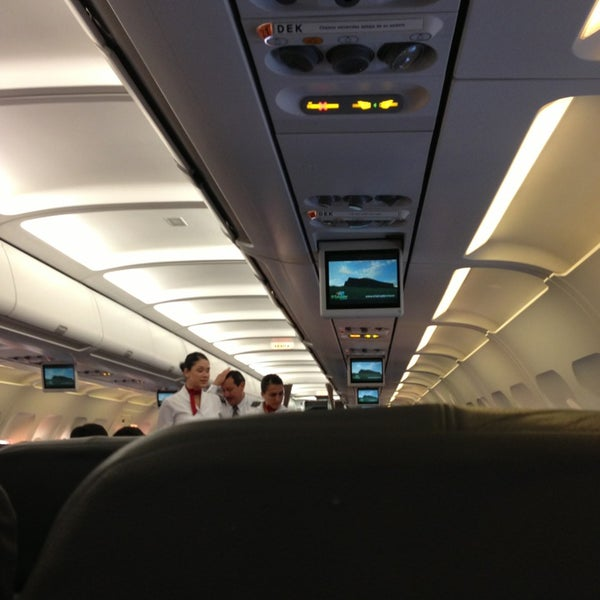 Photo taken at Gate 5 Aeropuerto Internacional Juan Santamaria by Nicole B. on 1/24/2013