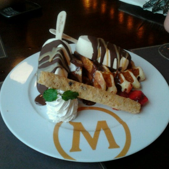Photo taken at The New Magnum Café by Sahala S. on 9/7/2013