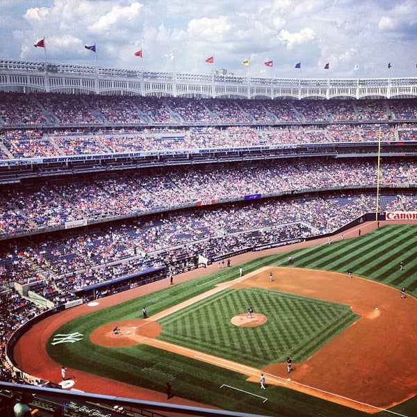 Photo taken at Yankee Stadium by Manny L. on 7/27/2013