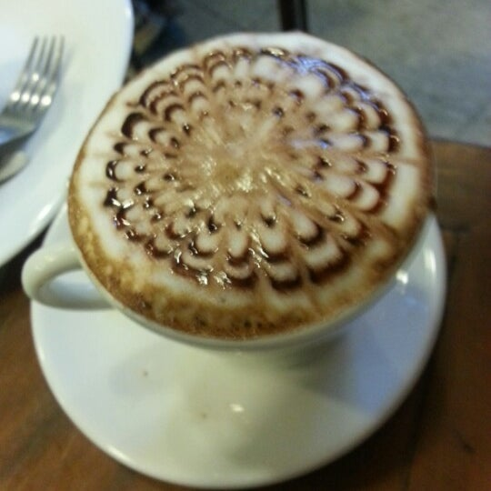 Photo taken at Café Book by Manuela D. on 11/23/2012