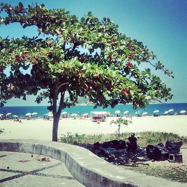Photo taken at Praia da Barra da Tijuca by Leandro G. on 3/15/2014