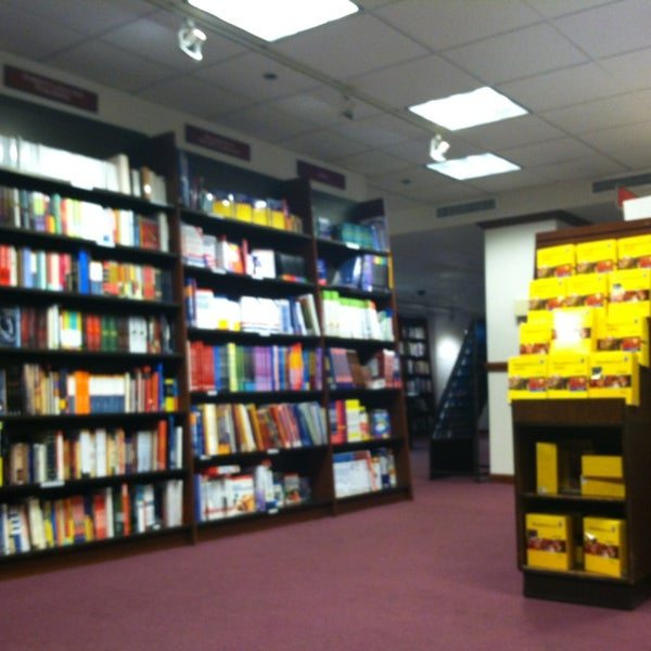 Photo taken at Harvard Coop Society Bookstore by Erika W. on 12/18/2012