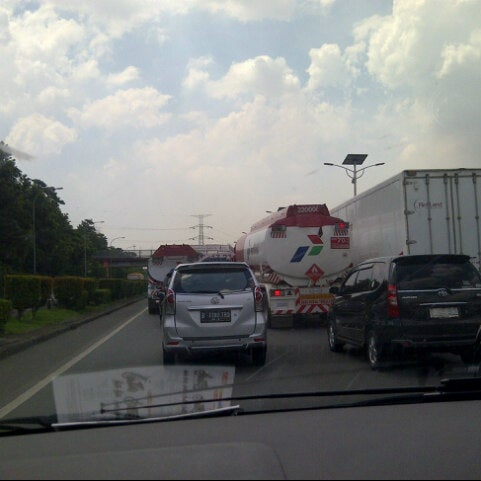 Photo taken at Gerbang Tol Cililitan by Samuel on 4/17/2014