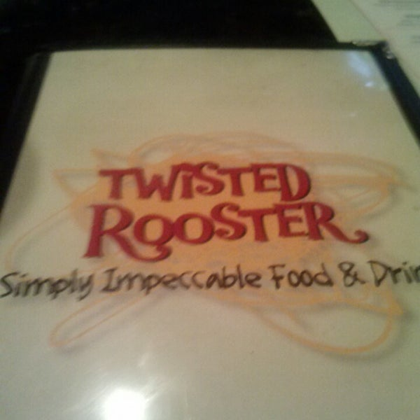 Photo taken at Twisted Rooster by Bryce on 4/18/2014