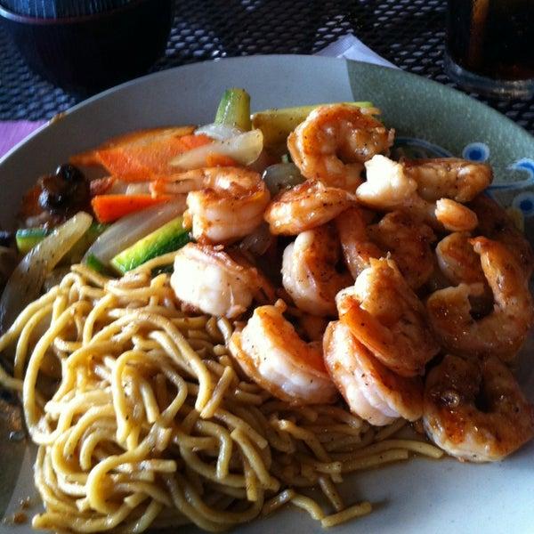 Photo taken at Sushi Cafe by Pamela D. on 6/15/2013