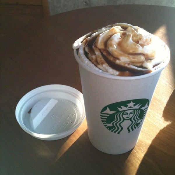 Photo taken at Starbucks by Kyungae H. on 3/23/2014