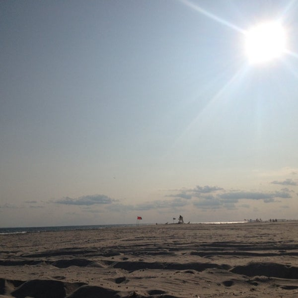 Photo taken at East Atlantic Beach by Adam M. on 7/30/2014