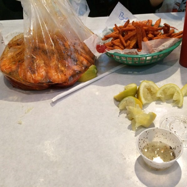 Photo taken at The Boiling Crab by Farah A. on 2/22/2014