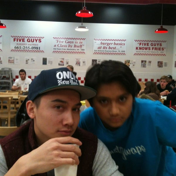 Photo taken at Five Guys by Chiro Y. on 12/28/2012