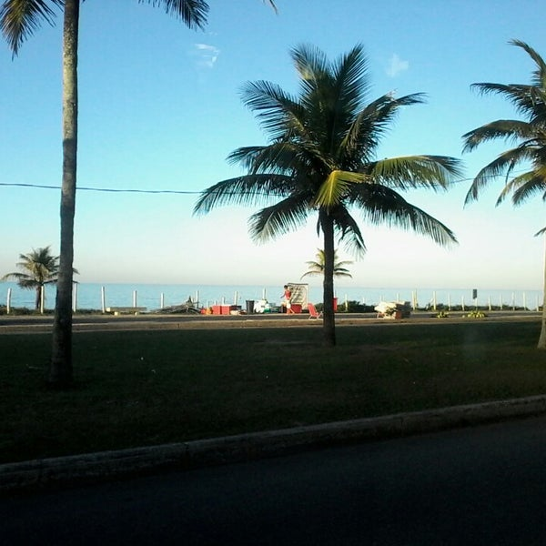 Photo taken at Praia da Barra da Tijuca by Josias J. on 3/15/2014