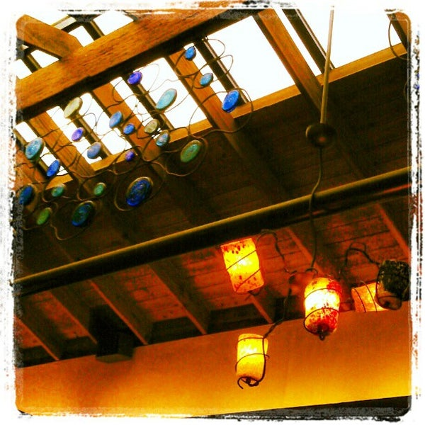Photo taken at Fat Fish Cantina Grill by Alexander N. on 1/4/2013