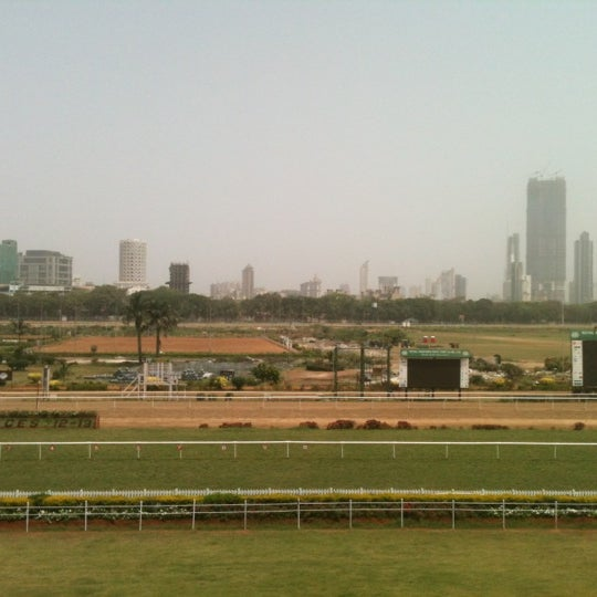 Photo taken at Mahalaxmi Race Course (Royal Western India Turf Club) by Adil J. on 4/10/2013