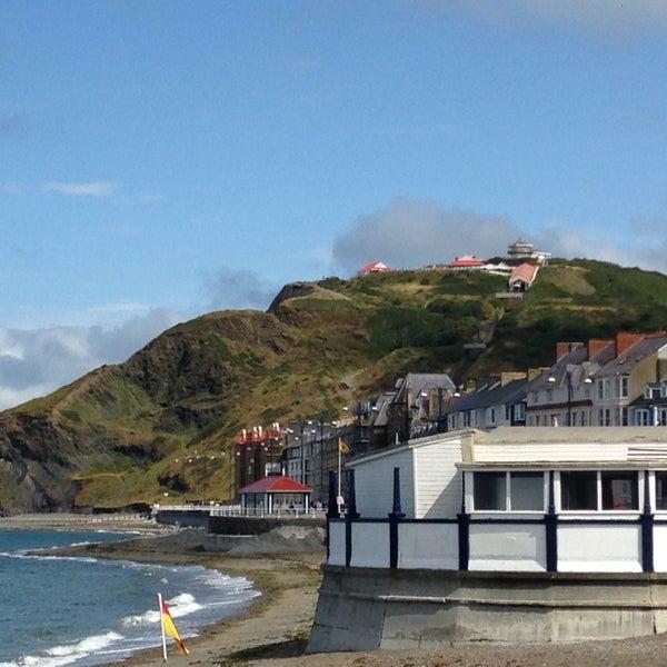Photo taken at Aberystwyth Beach by John Paul G. on 8/2/2014