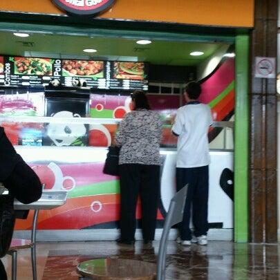 Photo taken at Área de Comida Rápida by Hector A. on 10/29/2012