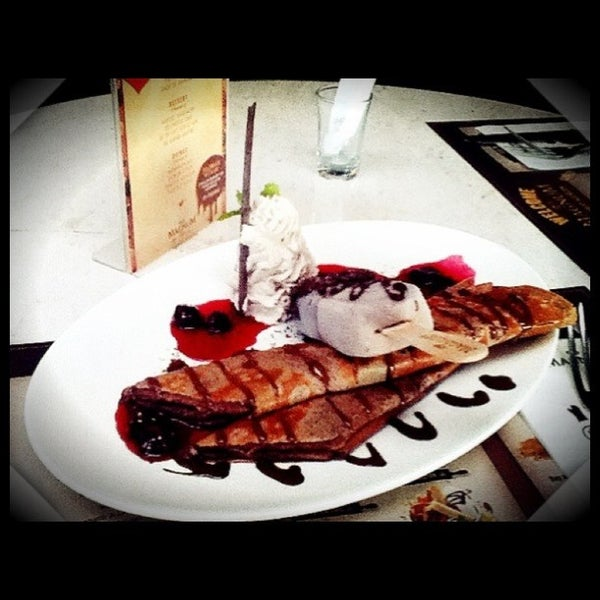 Photo taken at The New Magnum Café by Angeline W. on 2/18/2013