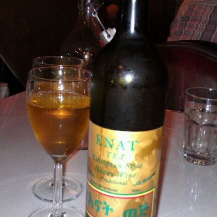 Photo taken at New Eritrea Restaurant & Bar by Melissa V. on 10/25/2011