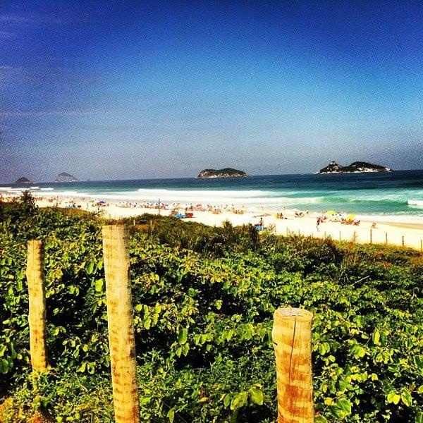 Photo taken at Praia da Barra da Tijuca by Denise on 4/27/2013