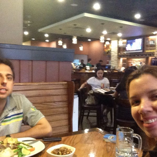 Photo taken at Outback Steakhouse by Renata P. on 4/20/2014