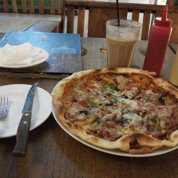 Photo taken at JAVA BEAN Coffee & Resto by Tya K. on 12/3/2013