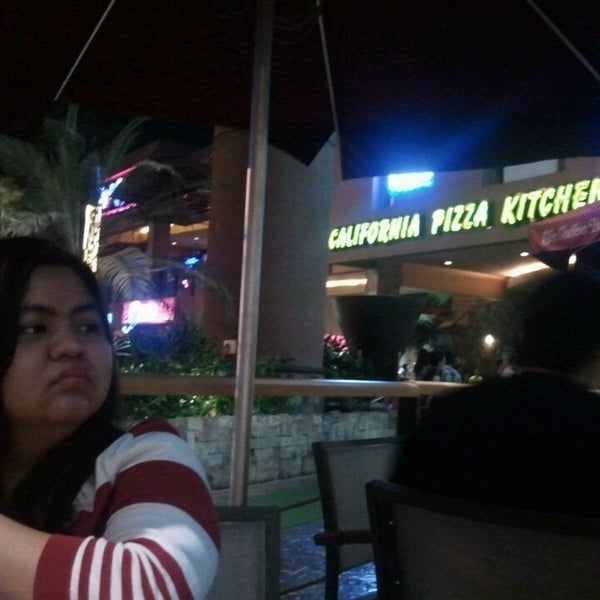 Photo taken at California Pizza Kitchen by Christian C. on 3/1/2014