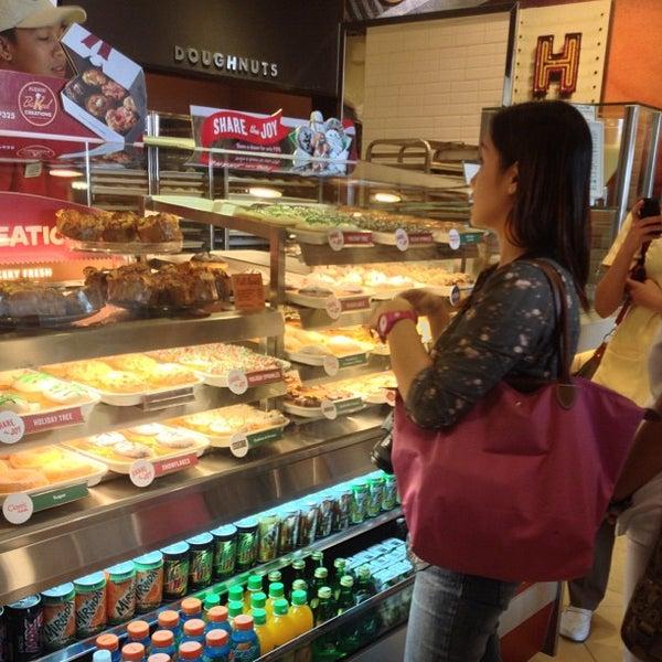 Photo taken at Krispy Kreme by Eva E. on 12/1/2012