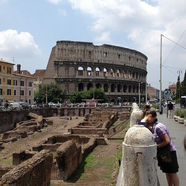 Photo taken at Piazza del Colosseo by Dmitry G. on 7/11/2013