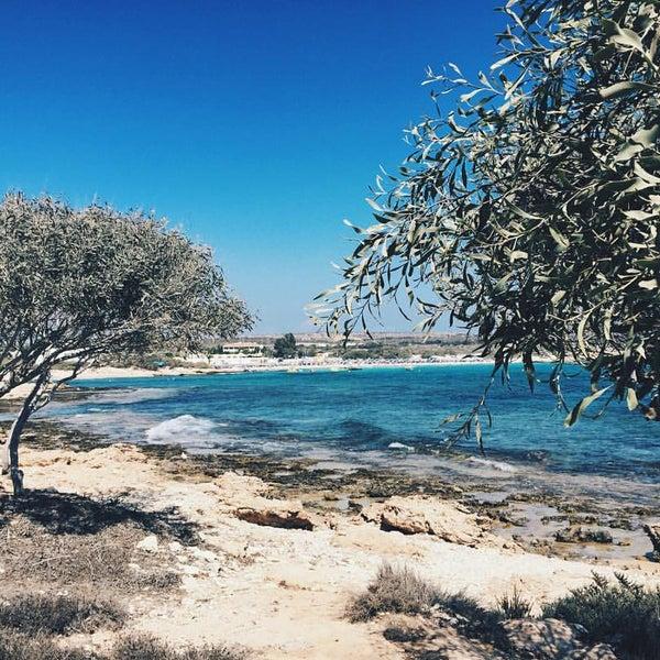 Photo taken at Makronissos beach by Dasha on 9/14/2016