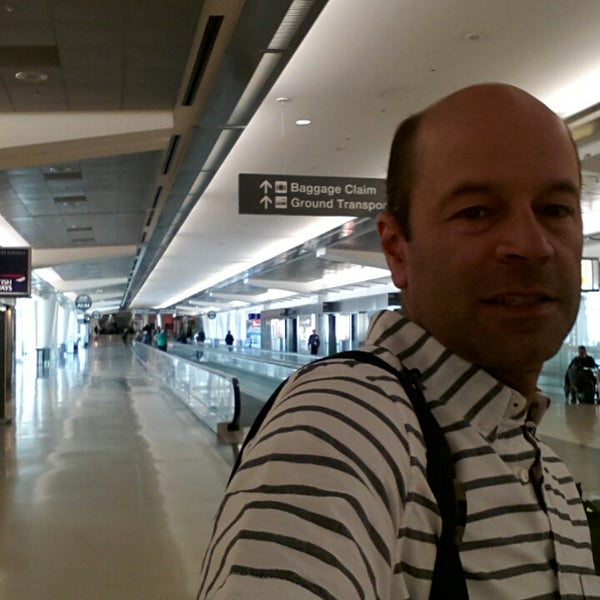 Photo taken at San Francisco International Airport (SFO) by Helio C. on 3/11/2014