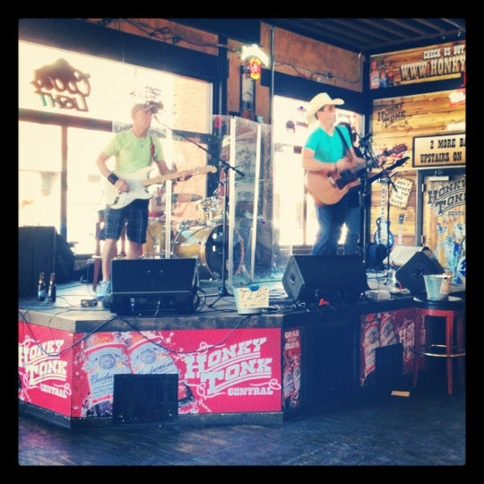 Photo taken at Honky Tonk Central by Emily N. on 9/22/2012
