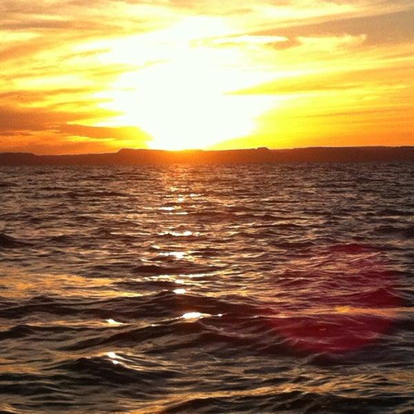 Photo taken at Playa Pichilingue by Cristina M. on 12/28/2012