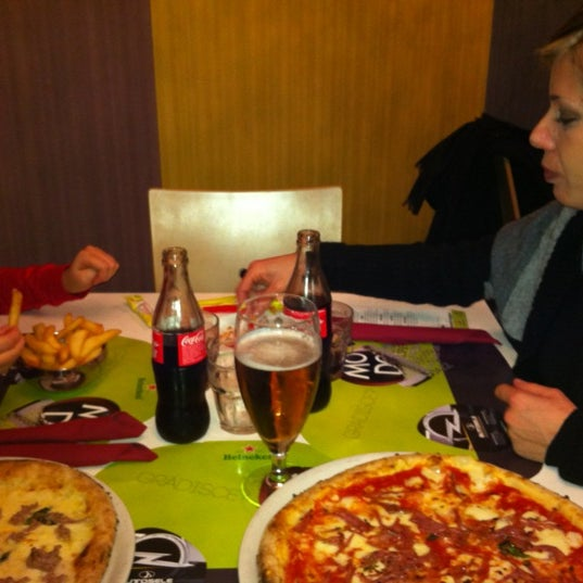 Photo taken at Pizzeria Ristorante Modo by Mauro V. on 12/16/2011