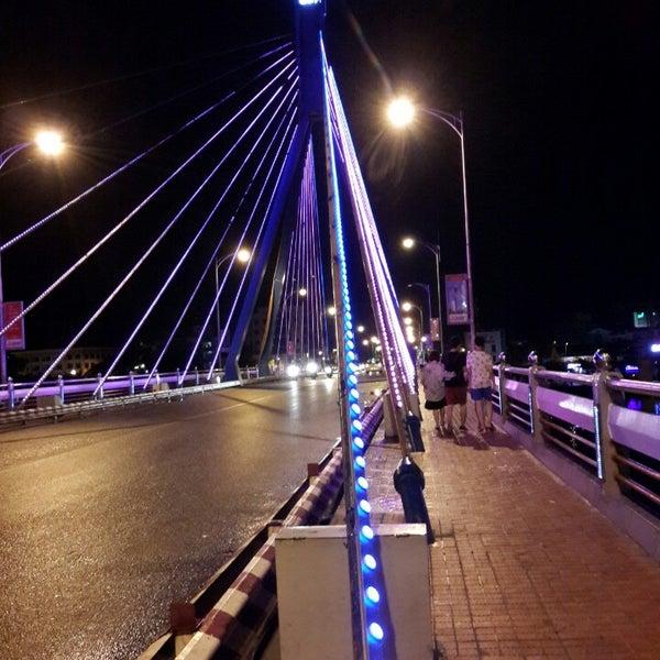 Photo taken at Cầu Sông Hàn (Han River Bridge) by Hozu H. on 7/17/2014