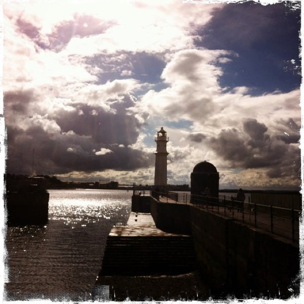 Photo taken at Newhaven Harbour by Tom B. on 6/22/2013