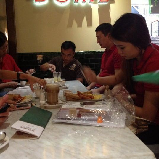 Photo taken at Dôme Café by Chin Liang on 11/1/2012