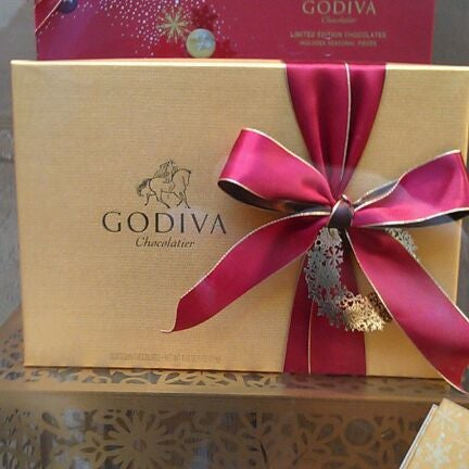 Photo taken at Godiva Chocolatier by Richard F. on 12/1/2011