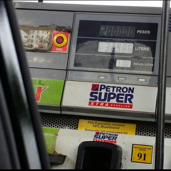 Photo taken at Petron by Kim G. on 6/20/2014