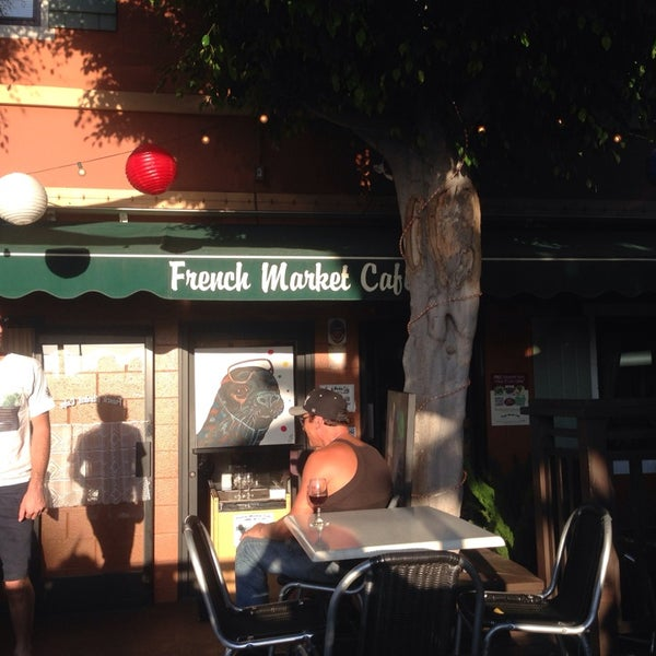 Photo taken at French Market Café by Christian Q. on 9/14/2014