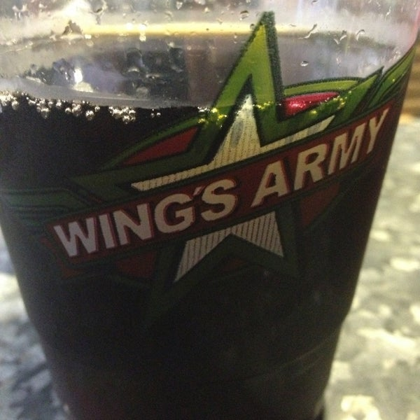 Photo taken at Wings Army by Oso P. on 7/12/2013