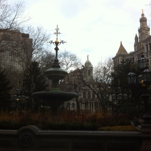 Photo taken at City Hall Park by Justin O. on 3/8/2014