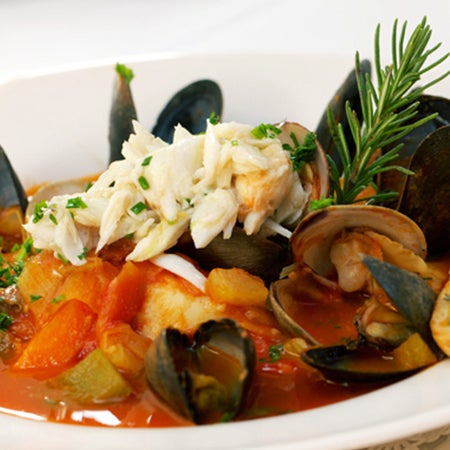 Local seafood shines here, especially in the bouillabaisse. It brims with tender fruits de mer in a robust saffron-tomato broth. Via CityEats.com