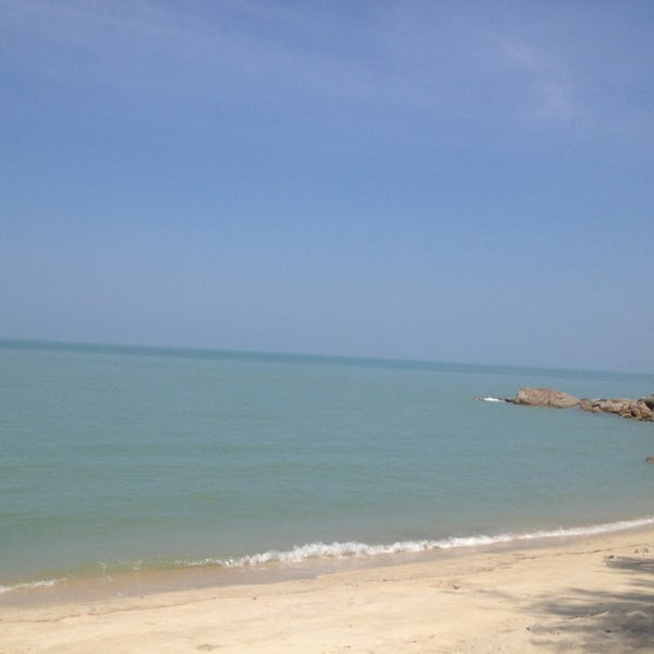 Photo taken at Teluk Bahang Beach by Kei K. on 2/5/2014