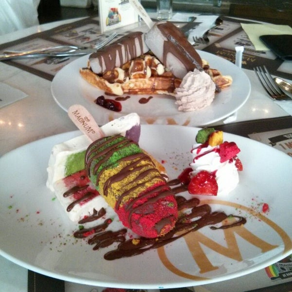 Photo taken at The New Magnum Café by Daniel B. on 4/4/2013
