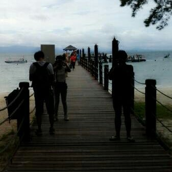 Photo taken at Manukan Island Jetty by Dira W. on 10/24/2013